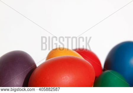 Colored Painted Easter Eggs In Wooden Basket Decoration In Preparation For Holiday. Painting Chicken