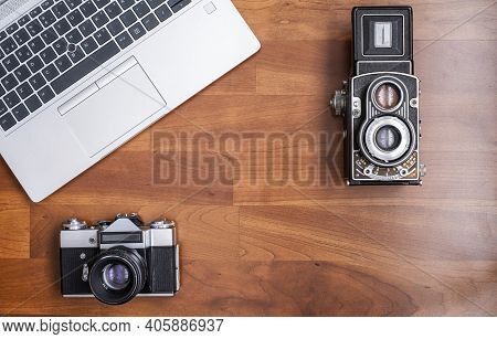 An Old 35mm Reflex Camera, And An Old Medium Format Twin Lens Reflex Camera, Seen From Above With A