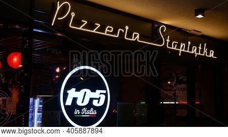 Warsaw, Poland. 31 January 2021. Sign Pizzeria Stopiatka. Company Signboard Pizzeria Stopiatka.