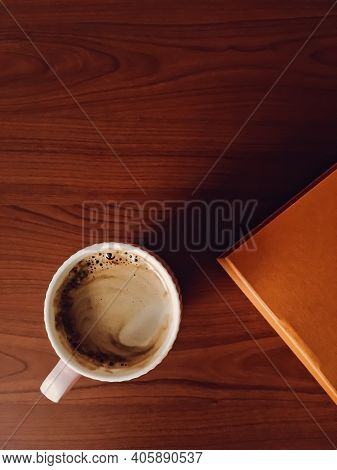 Coffee Cup On Wooden Desk, Flat Lay Background And Business Mockup