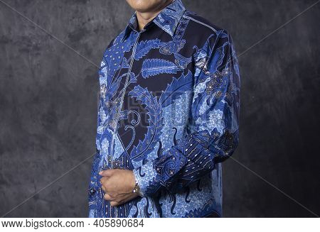 Portrait Of A Man Wearing A Government Service Batik. Clothes With Blue Batik Motifs. Government Shi