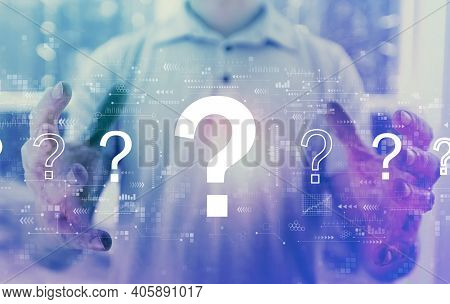 Question Marks With Young Man Holding His Hands