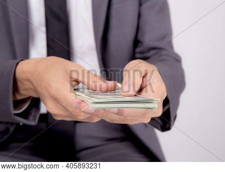 Hand Of Business Man Giving Money Isolated On White Background, Finance And Cash, Businessman Holdin