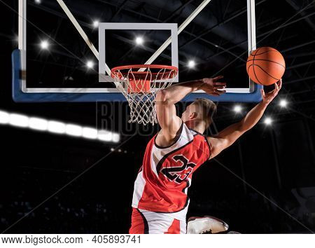 Basketball player players in action. Basketball concept on black background
