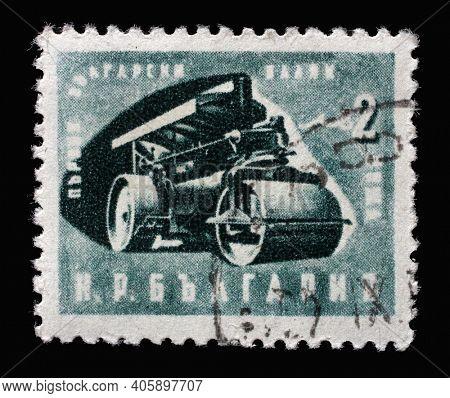 ZAGREB, CROATIA - SEPTEMBER 03, 2014: Stamp printed in Bulgaria shows first Bulgarian steamroller, circa 1951