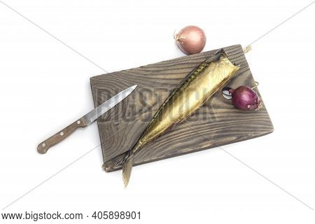 Knife, Onion And One Delicious, Smoked Headless Mackerel On A Cutting Board On A White Background Cl