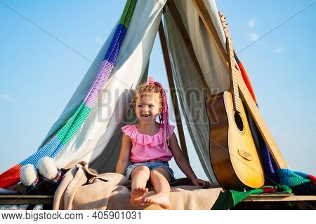 Smiling Kid In Tent. Girl Playing In Camp. Kids Camping. Having Fun Outdoors. Campground