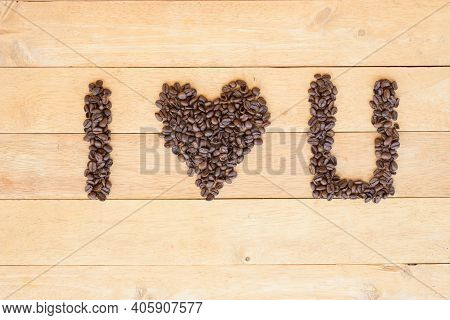 Top View Of Coffee Bean Sort To Love Coffee Word Plate