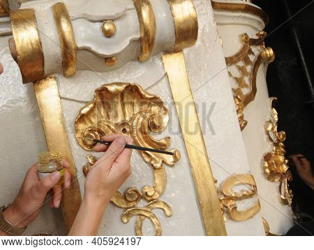 Restorer Manually Gilding Listed Interior, Restoration Works And Repairing Works
