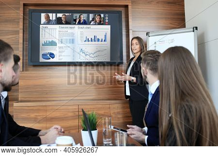 Business Team At Office, Businessman Presenting And Discussing Successful Financial Report Of Their