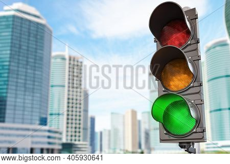 Traffic light with green light on urban skyscrapers city background. 3d illustration