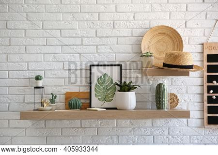 Shelves With Decorative Elements On White Brick Wall. Interior Design