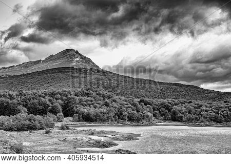 Sunset over Cerro Guanaco seen from the Black Laggon (Laguna negra) in Tierra del Fuego National Park, Argentina. In black and white