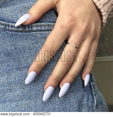 Stylish Trendy Blue Female Manicure.hands Of A Woman With Blue Manicure On Nails