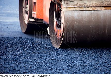 Construction Site Is Laying New Asphalt Road Pavement,road Construction Workers And Road Constructio
