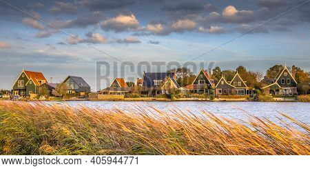 Traditional Village Scene With Wooden Houses On The Waterfront In Groot Schermer, North Holland, Net