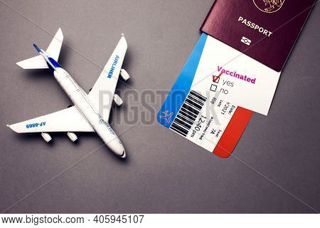 Traveling During Covid-19 Pandemic, Passport With Airline Ticket, Covid-19 Vaccinated Card With