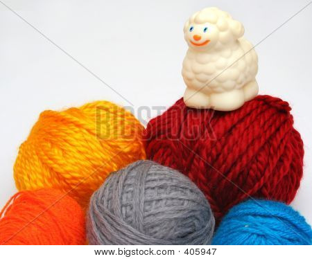 sheep over balls of yarn poster