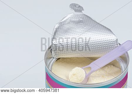 Infant Formula In Spoon. High Angle View Of Baby Formula And Spoon In Can. Baby Infant Food Powder M