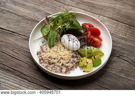 Quinoa Porridge Breakfast With Oatmeal, Poached Egg
