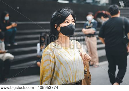 Virus Mask Asian Woman Wearing A Mask To Prevent The Coronavirus Virus, Lady Waiting For The Bus To