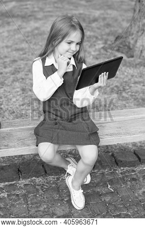 E-book For Your School Library. Happy Kid Read E-book. E-reader Or Tablet Computer. Reading Online.