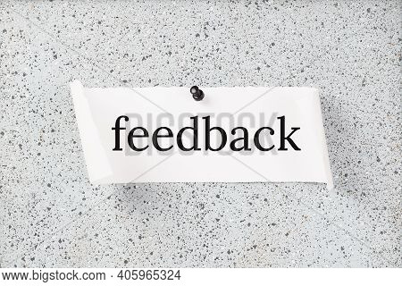 Feedback Text On A Grey Notice Board