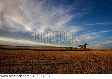On The Empty Field After Harvesting In Summer Evening. Czech Republic. Amazing Sunset In Czech Bohem