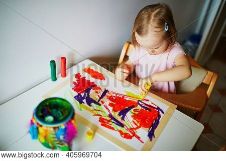 Adorable Little Girl Drawing With Colorful Paints At Home, In Kindergarten Or Preschool. Creative Ga