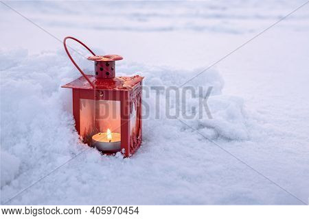 Street Winter Candle In The Snow, Retro Lantern With Burning Candle On Fresh White Fluffy Snow, Fest