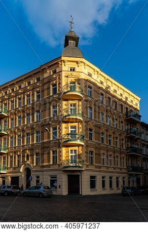 Wroclaw, Poland - March 1 2020 Facade Of Corner Of Yellow Old Tenement House With Dome On Top