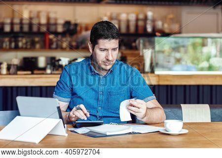 Mature Restaurant Owner Calculating Finance And Bills Of New Business - Entrepreneur Online Using Ta