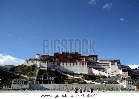 Potala Palace in Lhasa with blue background.