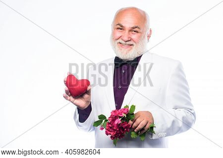Senior Gentleman Romantic Soul. Man Hold Heart Symbol Of Love. Romance And Dating. Dating Services F