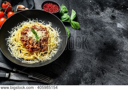 Italian Spaghetti Pasta With Tomato Sauce, Cheese Parmesan And Basil. Black Background. Top View. Co