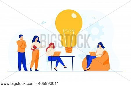 Business Team Meeting In Office Or Co-working Space. Colleagues Sitting At Desk, Working With Comput
