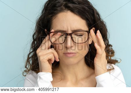 Sleepy Young Caucasian Business Woman In Glasses Rubbing Eyes, Feels Tired After Working On Laptop,