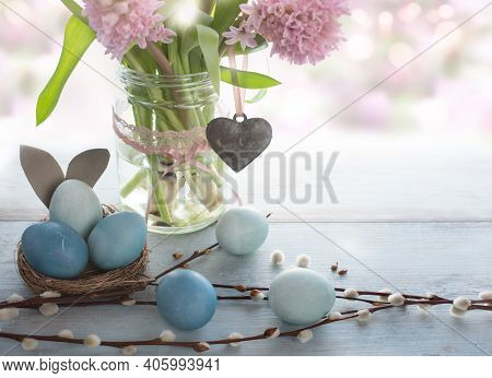 Spring Easter Decoration With Pink Flowers And Pastel Blue Eggs. Space For Text. Close Up With Short