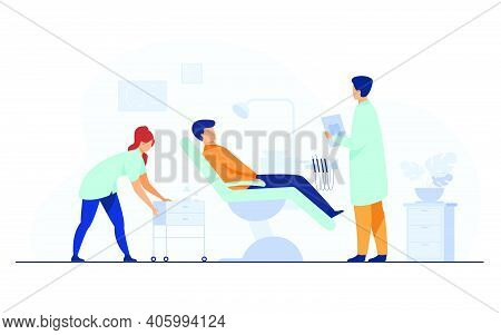 Dental Clinic Concept. Patient Visiting Dentist Office, Sitting In Chair While Doctor Examining Him