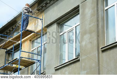 Kyiv, Ukraine - February 08, 2021:  Exterior House Rendering: A Building Contractor On Scaffolding I