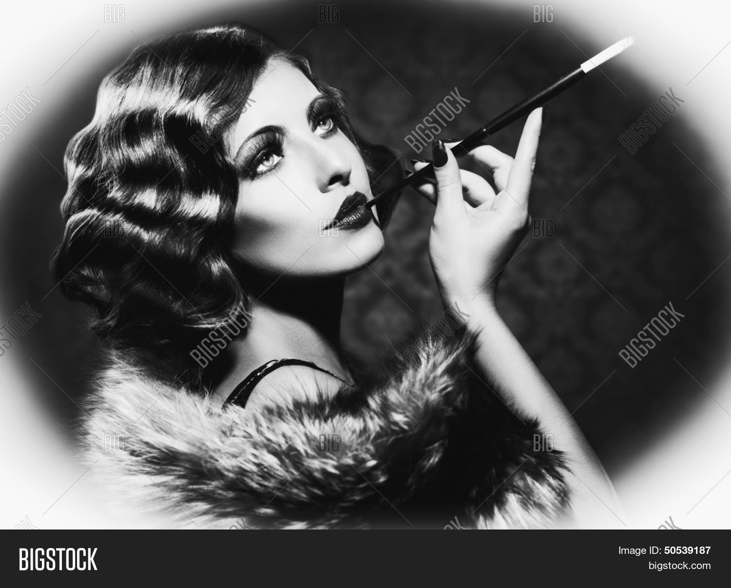 Retro woman portrait beautiful woman with mouthpiece cigarette smoking lady vintage styled