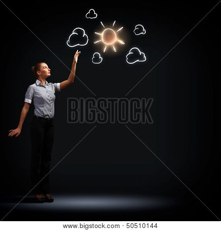 Image of attractive businesswoman against dark background with sun poster