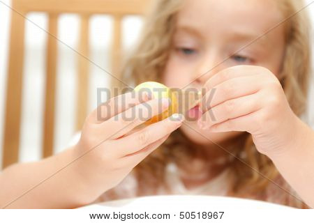 Girl peeling potato