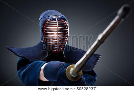 Portrait of kendoka with bamboo sword. Japanese martial art of sword fighting