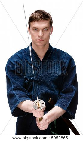 Kendo fighter in hakama training with bokken, isolated on white. Japanese martial art of sword fighting