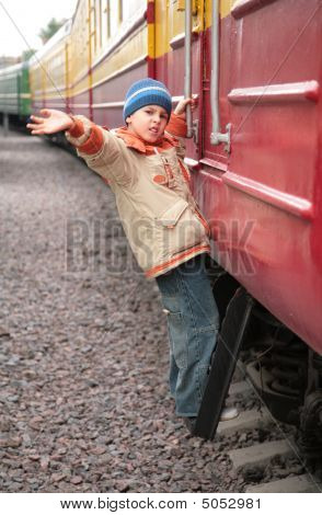 Boy On Footboard Of Passenger Wagon
