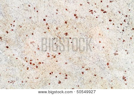 Yellow Granite Structure With Red Dots