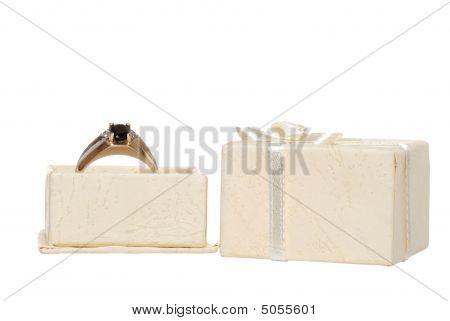 Mens Blue Saphire Ring In A Cream Colored Jewllery Box