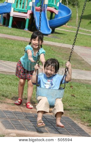 Girl & Boy At The Swing