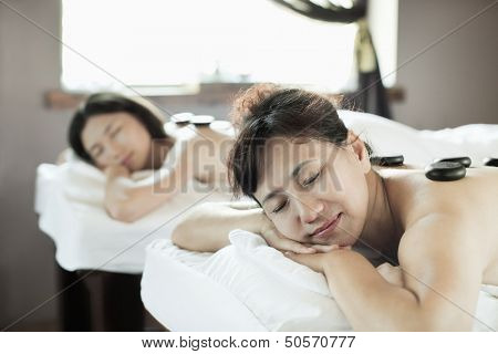 Mother and Daughter Having Hot Stone Massage Together